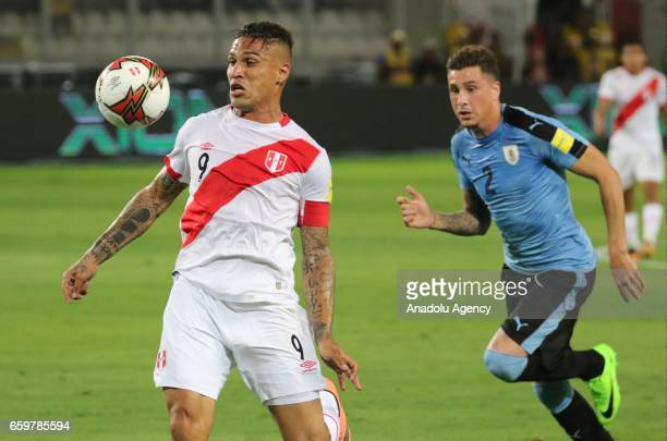 Paolo Guerrero of Peru in action against Jose Gimenez of Uruguay during 2018 FIFA World Cup Qualification match between Peru and Uruguay at National...