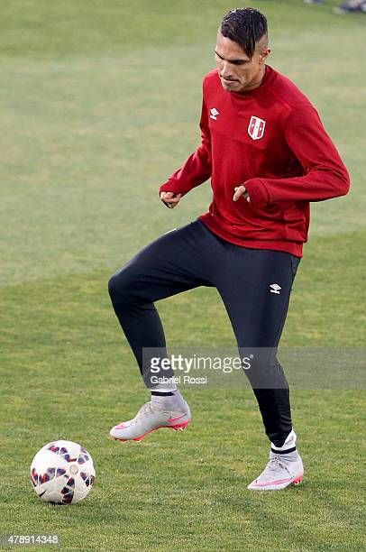 Paolo Guerrero of Peru kicks the ball during a field scouting prior to the semi final match against Chile at Nacional Stadium as part of 2015 Copa...