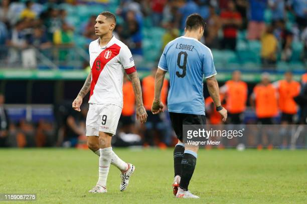 Paolo Guerrero of Peru prepares to take his penalty as Luis Suarez of Uruguay reacts after failing his during a penalty shootout after the Copa...