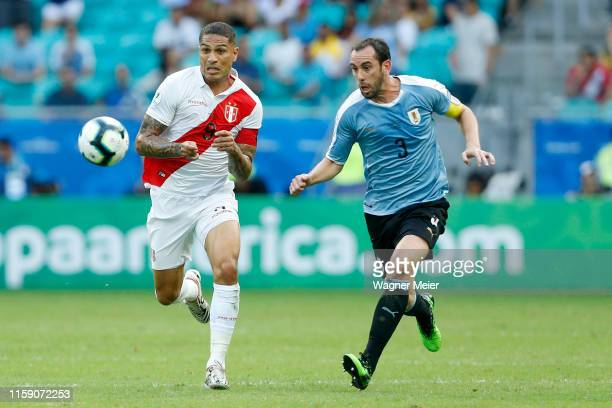 Paolo Guerrero of Peru runs after the ball against Diego Godin of Uruguay during the Copa America Brazil 2019 quarterfinal match between Uruguay and...
