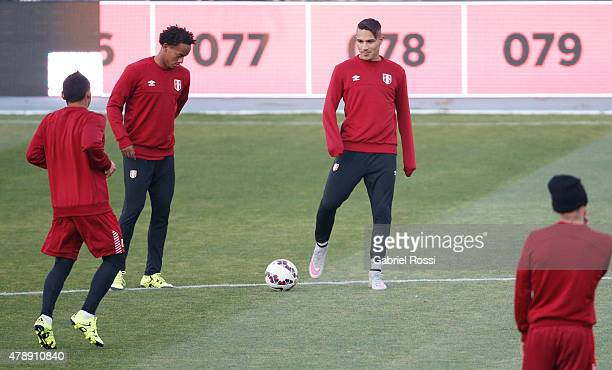 Paolo Guerrero of Peru watches the ball during a field scouting prior to the semi final match against Chile at Nacional Stadium as part of 2015 Copa...