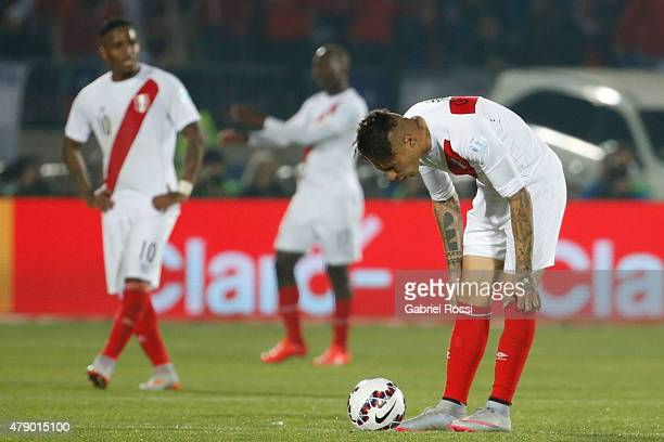 Paolo Guerrero of Peru watches the ball during the 2015 Copa America Chile Semi Final match between Chile and Peru at Nacional Stadium on June 29...