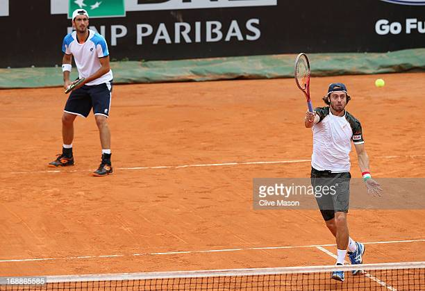 Paolo Lorenzi and Potito Starace of Italy in action during their match against Bob Bryan and Mike Bryan of the USA on day five of the Internazionali...