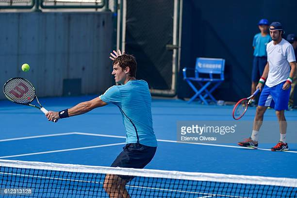 Paolo Lorenzi of Italy and Guido Pella of Argentina in action during the Men's double first round match against Max Mirnyi of Belarus and Treat Huey...
