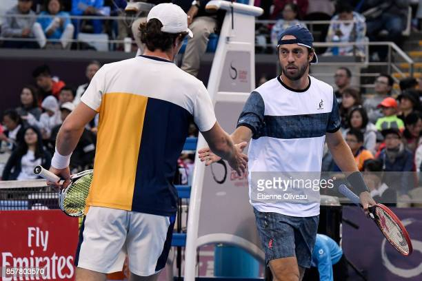 Paolo Lorenzi of Italy and Mischa Zverev of Germany check hands during their Men's doubles quarterfinal match against Juan Martin del Potro and...
