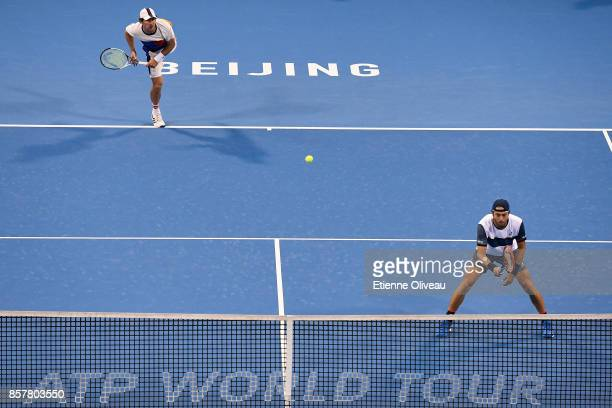 Paolo Lorenzi of Italy and Mischa Zverev of Germany in action against Juan Martin del Potro and Leonardo Mayer of Argentina during their Men's...