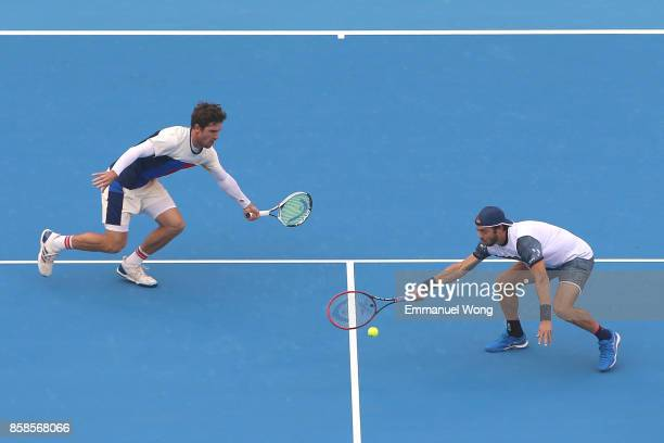 Paolo Lorenzi of Italy and Mischa Zverev of Germany return a shot during their Men's double semi finals match against Henri Kontinen of Finland and...