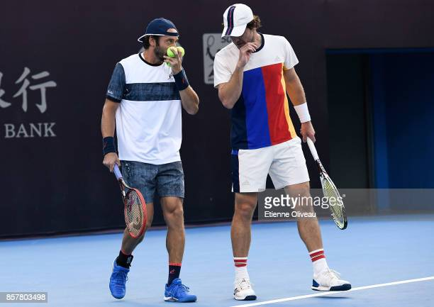 Paolo Lorenzi of Italy and Mischa Zverev of Germany talk tactics during their Men's doubles quarterfinal match against Juan Martin del Potro and...