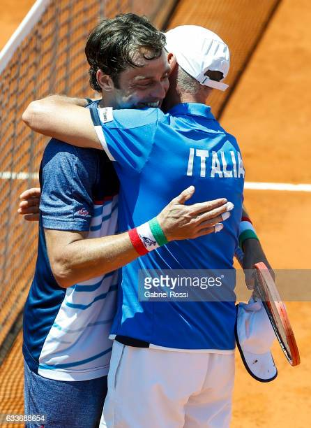 Paolo Lorenzi of Italy celebrates with Corrado Barazzutti captain of Italy after wining the singles match between Guido Pella and Paolo Lorenzi as...