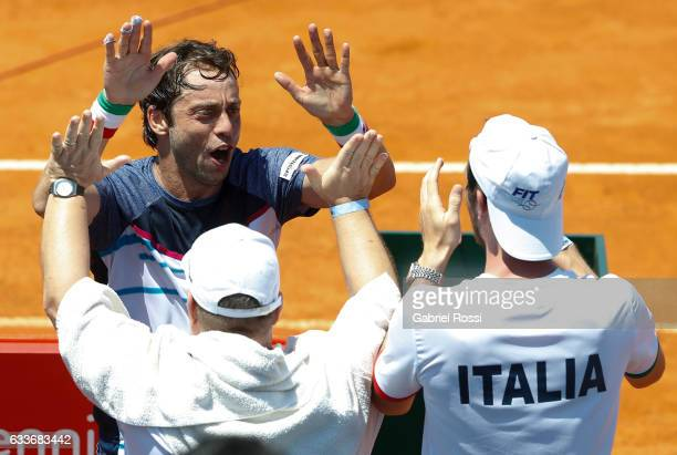 Paolo Lorenzi of Italy celebrates with teammates after winning the singles match between Guido Pella and Paolo Lorenzi as part day 1 of the Davis Cup...