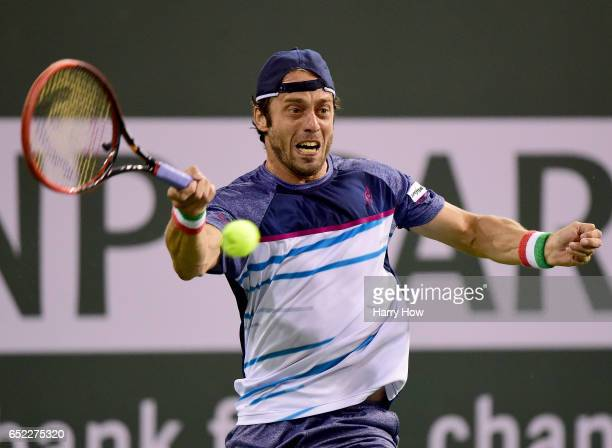 Paolo Lorenzi of Italy hits a forehand in a straight set loss to Stan Wawrinka of Switzerland during the BNP Paribas Open at Indian Wells Tennis...