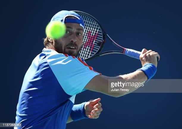 Paolo Lorenzi of Italy in action against Felix Auger-Aliassime of Canada in qualifying during day three of the Miami Open tennis on March 20, 2019 in...