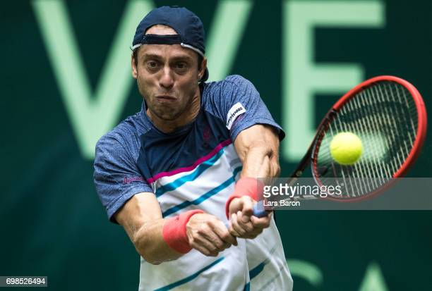 Paolo Lorenzi of Italy plays a backhand during his match against Alexander Zverev of Germany during Day 4 of the Gerry Weber Open 2017 at on June 20...