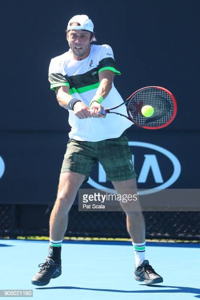 Paolo Lorenzi of Italy plays a backhand in his first round match against Damir Dzhumhur of Bosnia and Herzegovina on day one of the 2018 Australian...