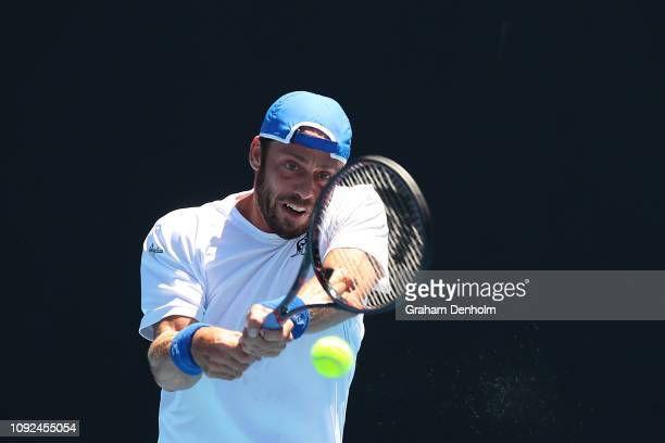 Paolo Lorenzi of Italy plays a backhand in his match against Daniel Evans of Great Britain during Qualifying ahead of the 2019 Australian Open at...