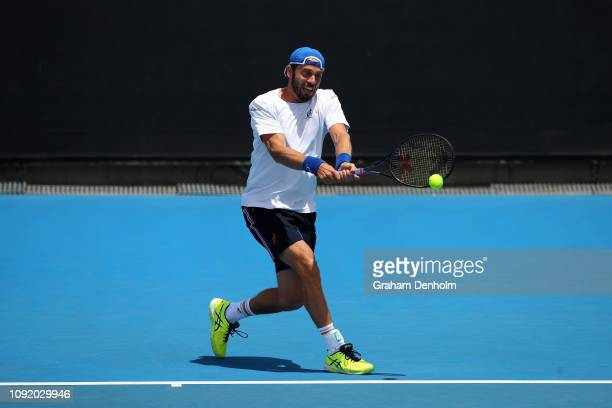 Paolo Lorenzi of Italy plays a backhand in his match against Tommy Paul of the United States during day three of Qualifying ahead of the 219...