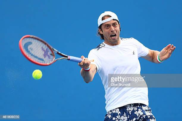 Paolo Lorenzi of Italy plays a forehand in his first round match against Alexandr Dolgopolov of the Ukraine during day two of the 2015 Australian...