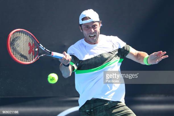 Paolo Lorenzi of Italy plays a forehand in his first round match against Damir Dzhumhur of Bosnia and Herzegovina on day one of the 2018 Australian...