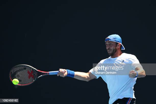 Paolo Lorenzi of Italy plays a forehand in his match against Daniel Evans of Great Britain during Qualifying ahead of the 2019 Australian Open at...
