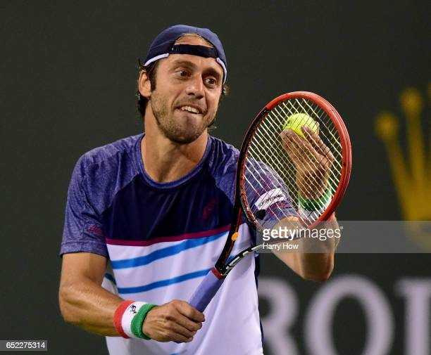 Paolo Lorenzi of Italy prepares to serve in a straight set loss to Stan Wawrinka of Switzerland during the BNP Paribas Open at Indian Wells Tennis...