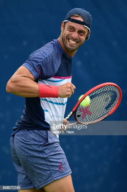 Paolo Lorenzi of Italy reacts after a point against Taylor Fritz during the fifth day of the Winston-Salem Open at Wake Forest University on August...