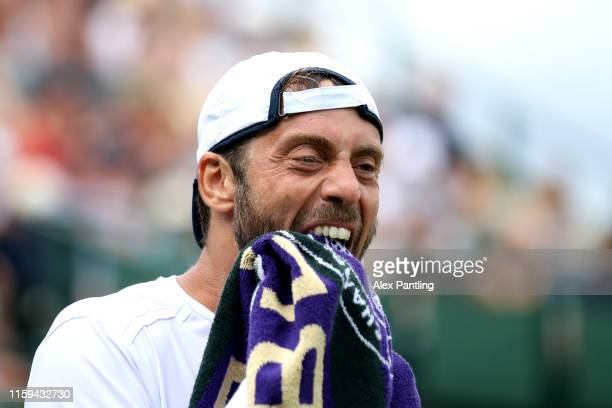 Paolo Lorenzi of Italy reacts in his Men's Singles first round match against Daniil Medvedev of Russia during Day one of The Championships -...