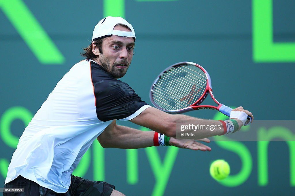 Paolo Lorenzi of Italy returns a shot against Nikolay Davydenko of Russia during Day 3 of the Sony Open at at the Crandon Park Tennis Center on March 20, 2013 in Key Biscayne, Florida.