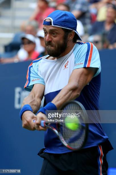 Paolo Lorenzi of Italy returns a shot during his Men's Singles third round match against Stan Wawrinka of Switzerland on day five of the 2019 US Open...