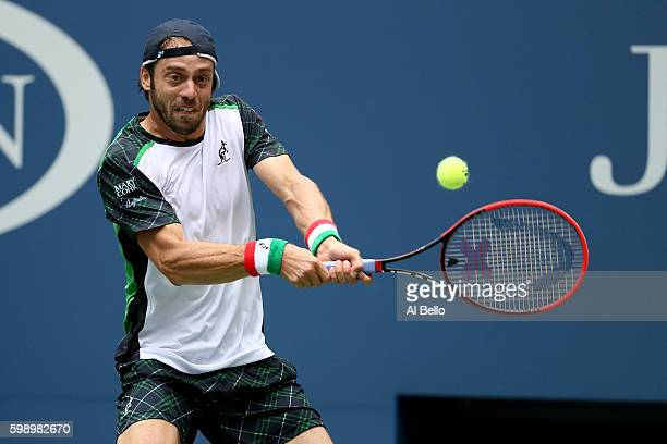 Paolo Lorenzi of Italy returns a shot to Andy Murray of Great Britain during his third round Men's Singles match on Day Six of the 2016 US Open at...