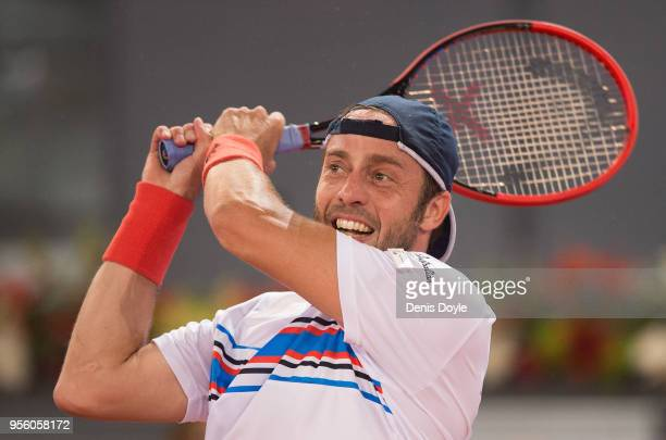 Paolo Lorenzi of Italy returns a shot to Fernando Verdasco of Spain in the 1st Round match during day four of the Mutua Madrid Open tennis tournament...