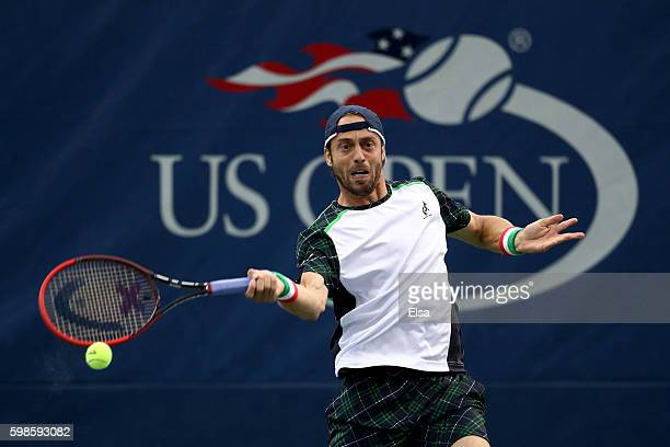 Paolo Lorenzi of Italy returns a shot to Gilles Simon of France during his second round Men's Singles match on Day Four of the 2016 US Open at the...