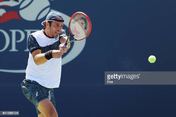 Paolo Lorenzi of Italy returns a shot to Thomas Fabbiano of Italy during their third round match on Day Five of the 2017 US Open at the USTA Billie...