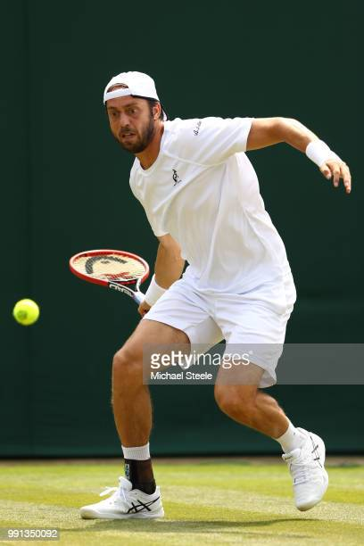Paolo Lorenzi of Italy returns against Gael Monfils of France during their Men's Singles second round match on day three of the Wimbledon Lawn Tennis...