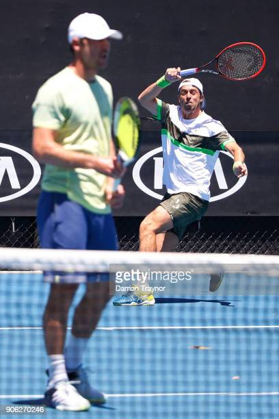 Paolo Lorenzi of Italy returns serve in his first round men's doubles match with Mischa Zverev of Germany against Lukasz Kubot of Poland and Marcelo...