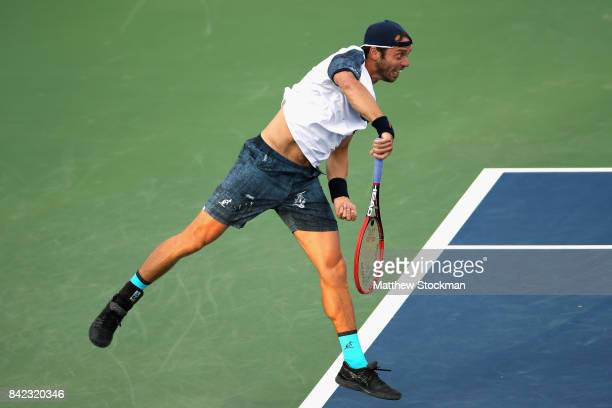 Paolo Lorenzi of Italy returns serves during his men's singles fourth round match against Kevin Anderson of South Africa on Day Seven of the 2017 US...