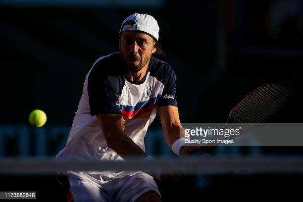 Paolo Lorenzi of Italy returns the ball during his Mens round of 32 match against Nicolas Alvarez of Peru on day two of the ATP Sevilla Chalenger at...