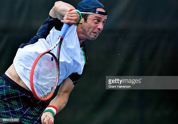 Paolo Lorenzi of Italy serves to Bjorn Fratangelo of the Unites States during the WinstonSalem Open at Wake Forest University on August 23 2016 in...