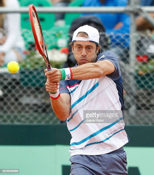 Paolo Lorenzi of Italy takes a backhand shot during a singles match between Carlos Berlocq and Paolo Lorenzi as part of day 3 of the Davis Cup 1st...