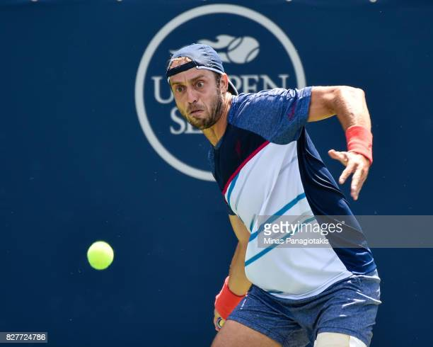 Paolo Lorenzi of Italy watches the ball closely as he prepares to hit a return shot against Frances Tiafoe of the United States during day five of...