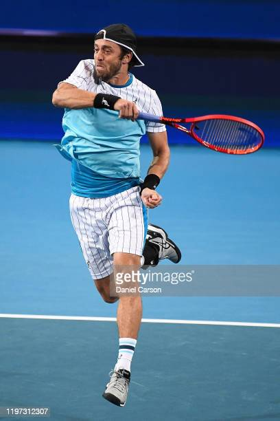 Paolo Lorenzi of Team Italy plays a forehand shot in his doubles match vs Team Russia during day one of the 2020 ATP Cup Group Stage at RAC Arena on...
