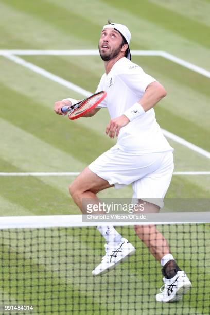 Paolo Lorenzi v Gael Monfils - Paolo Lorenzi looks up for the ball at All England Lawn Tennis and Croquet Club on July 4, 2018 in London, England.