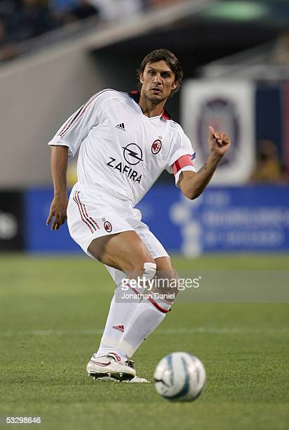 Paolo Maldini of AC Milan forwards a pass during a friendly match against the Chicago Fire on July 27 2005 at Soldier Field in Chicago Illinois AC...