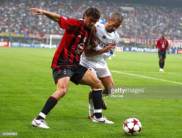 Paolo Maldini of AC Milan gets tackled by Juan Sebastian Veron of Inter during the Champions League Quarter Final first leg match between AC Milan...