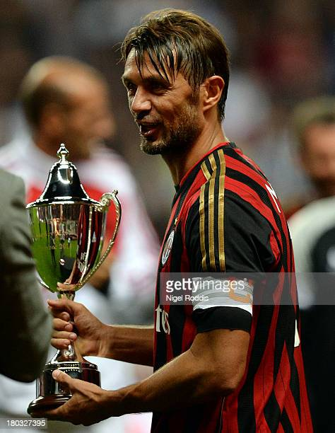 Paolo Maldini of AC Milan Glorie is seen holding the winners trophy at the end of Steve Harper's testimonial match between Newcastle United and AC...