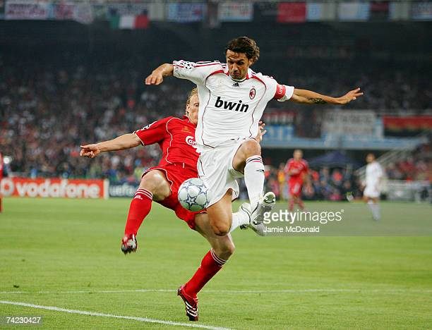 Paolo Maldini of AC Milan is challenged by Dirk Kuyt of Liverpool during the UEFA Champions League Final match between Liverpool and AC Milan at the...