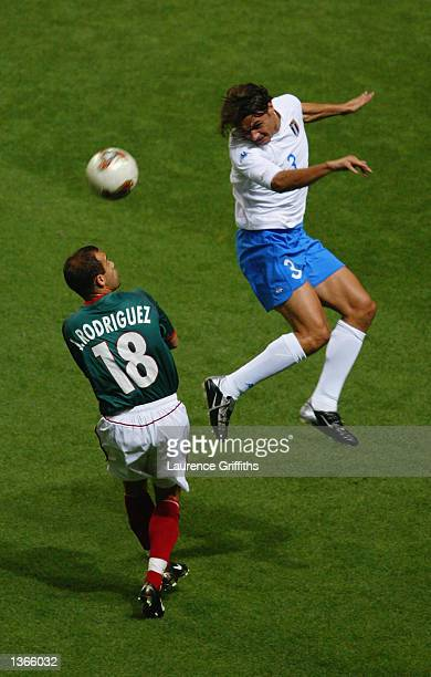 Paolo Maldini of Italy heads the ball past Joahan Rodriguez of Mexico during the FIFA World Cup Finals 2002 Group G match played at the Oita Big Eye...