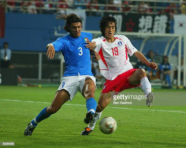 Paolo Maldini of Italy tackles Jung Hwan Ahn of South Korea during the FIFA World Cup Finals 2002 Second Round match played at the Daejeon World Cup...