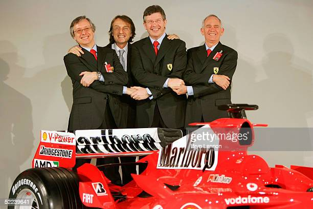 Paolo Martinelli Luca di Montezemolo Ross Rawn and Rory Byrne pose with the new Ferrari F2005 Formula One car photographed at its launch at the...
