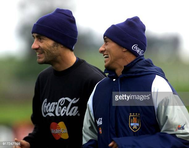 Paolo Montero and Dario Silva players of the Uruguyan soccer team run during a training session 19 June 2001 in Montevideo in preparation for the...