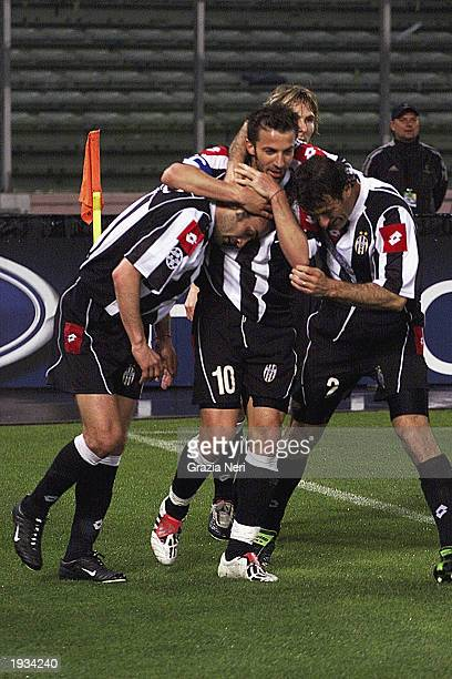 Paolo Montero of Juventus celebrates his goal with teammates Alessandro Del Piero and Ciro Ferrara during the UEFA Champions League quarterfinals...